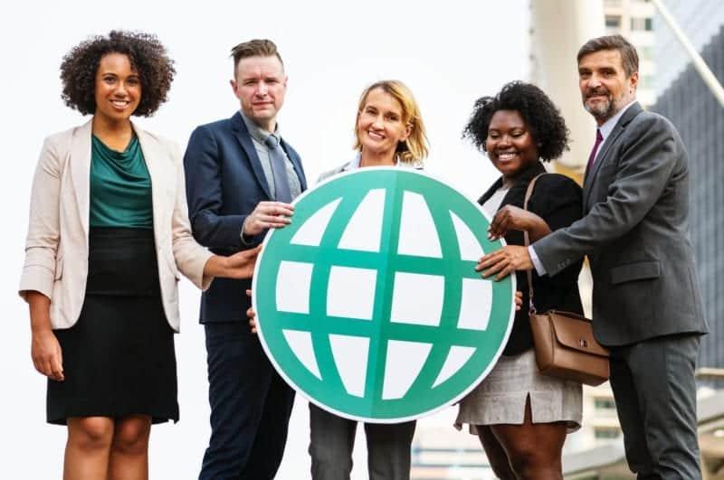 Team of MSPs holding globe
